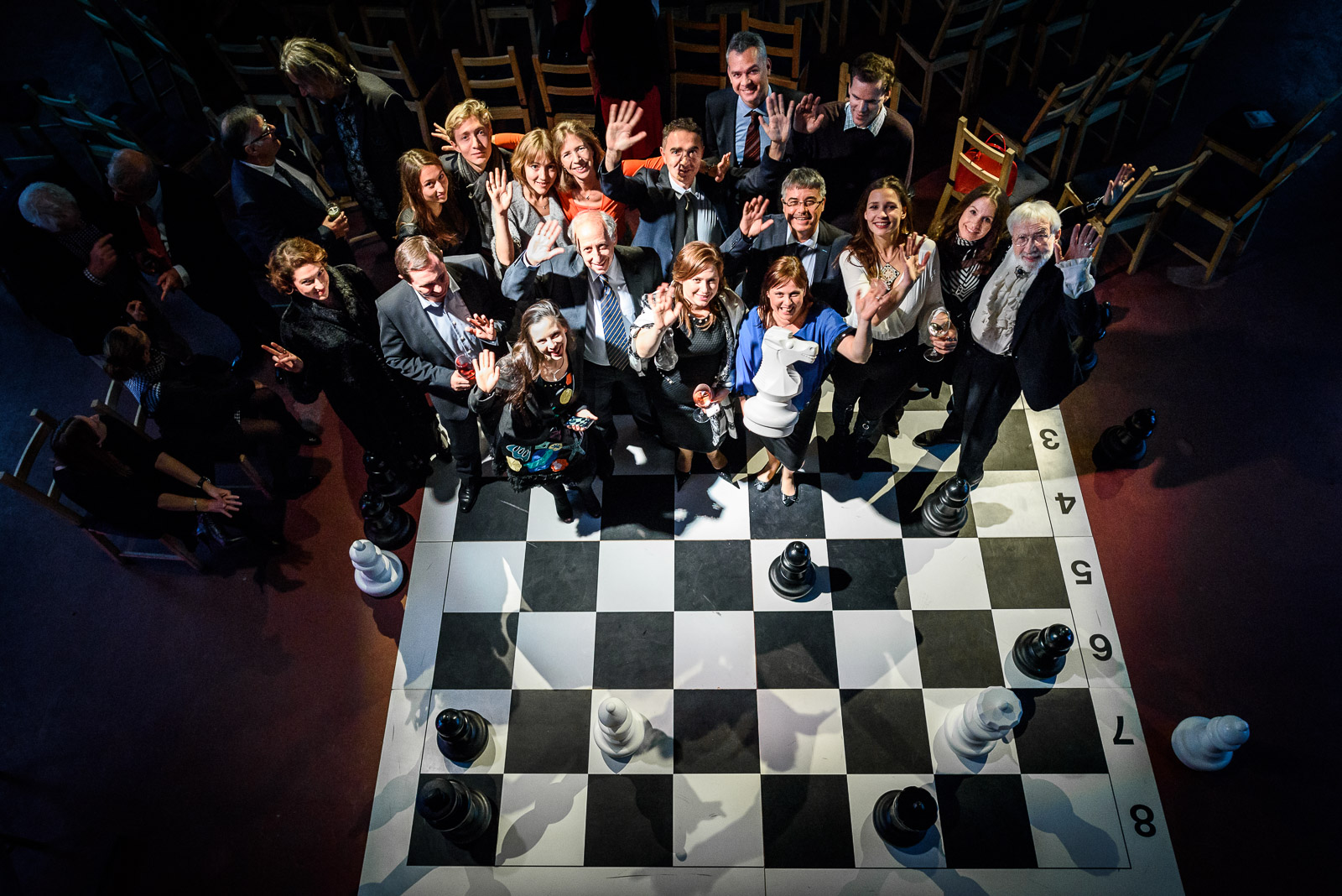 Group photo on large chess board